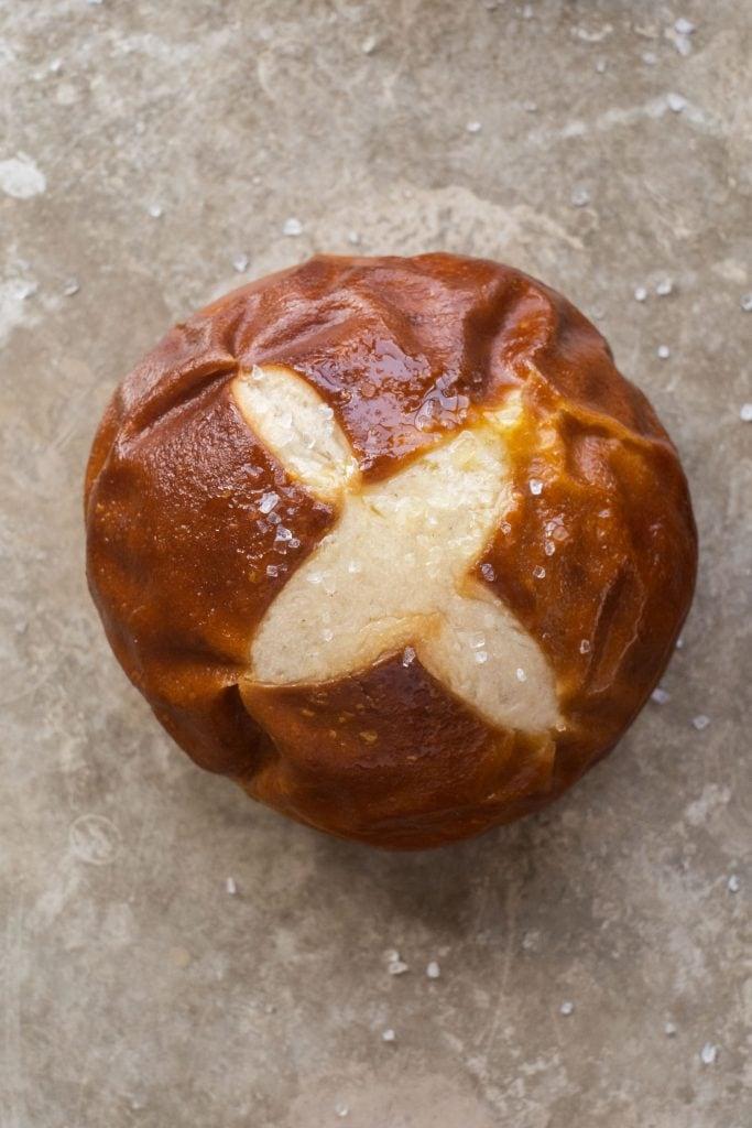 homemade pretzel rolls on baking sheet