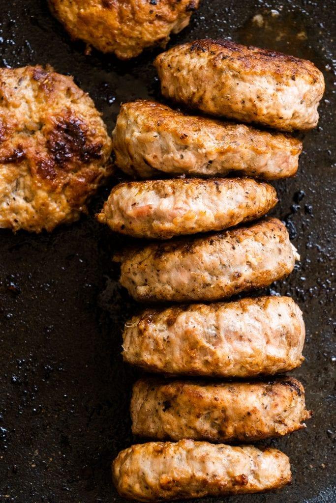 homemade breakfast sausage patties in greased frying pan