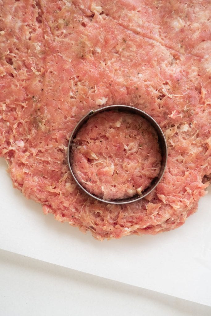 biscuit cutter cutting out sausage patty shapes