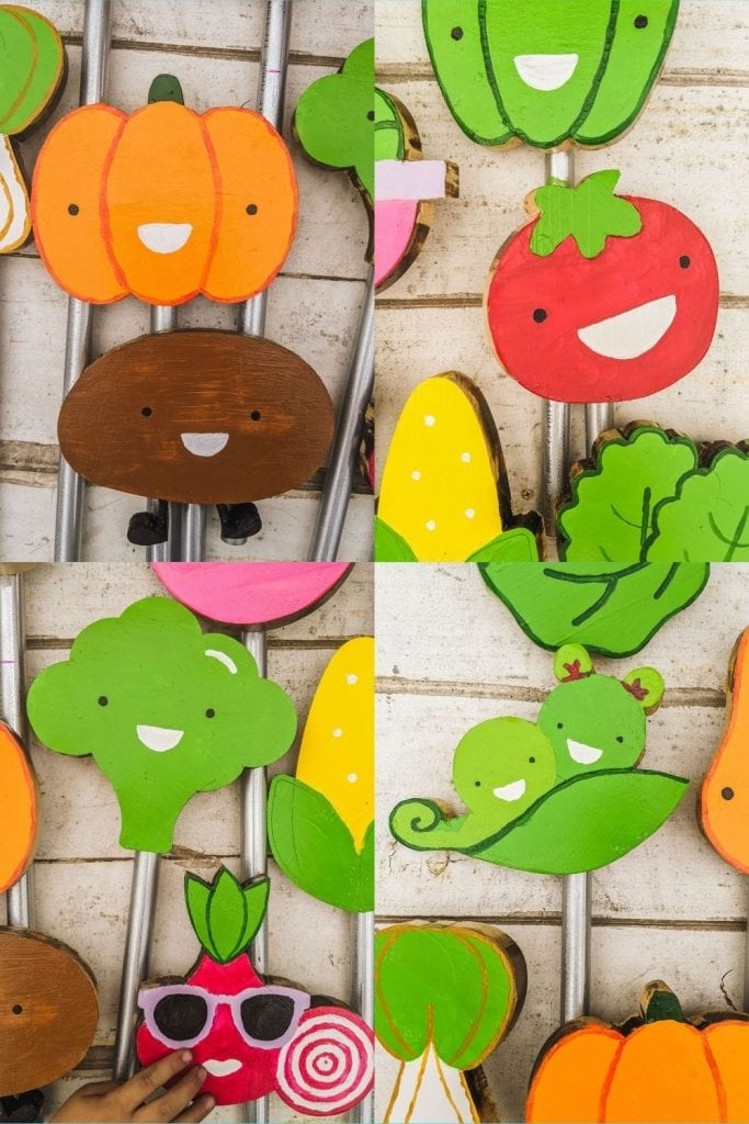 colorful pumpkin, potato, tomato, broccoli and pea garden signs on table.