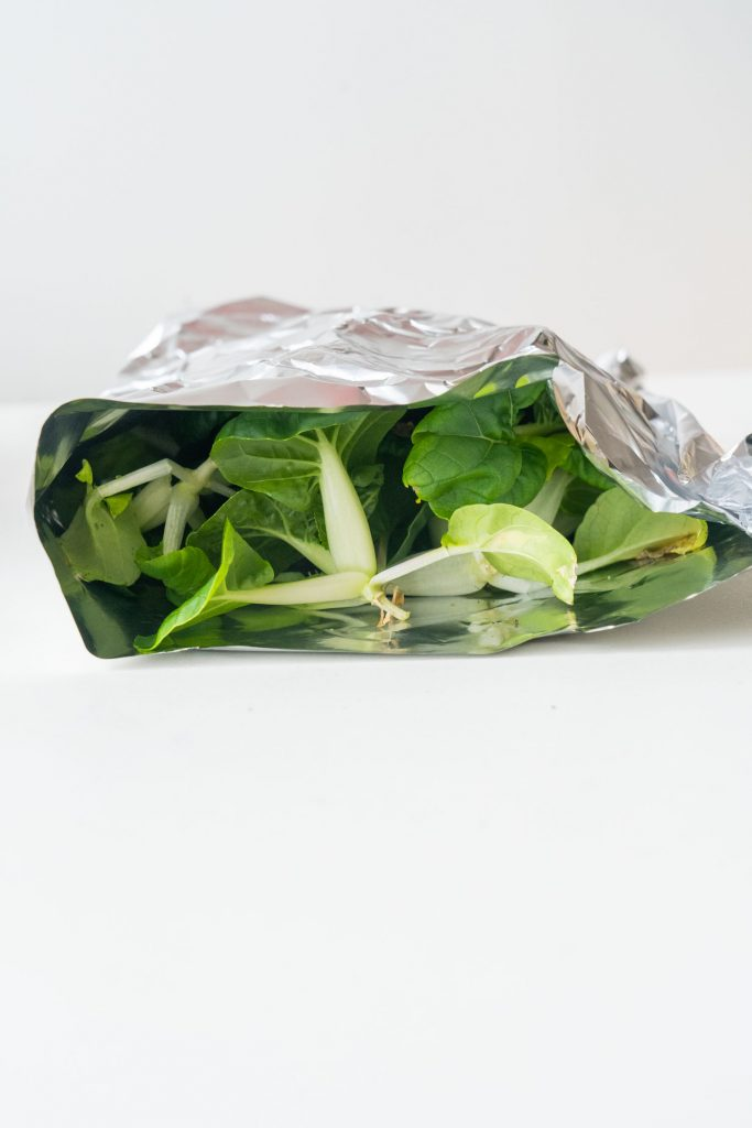 bok choy wrapped in aluminum foil