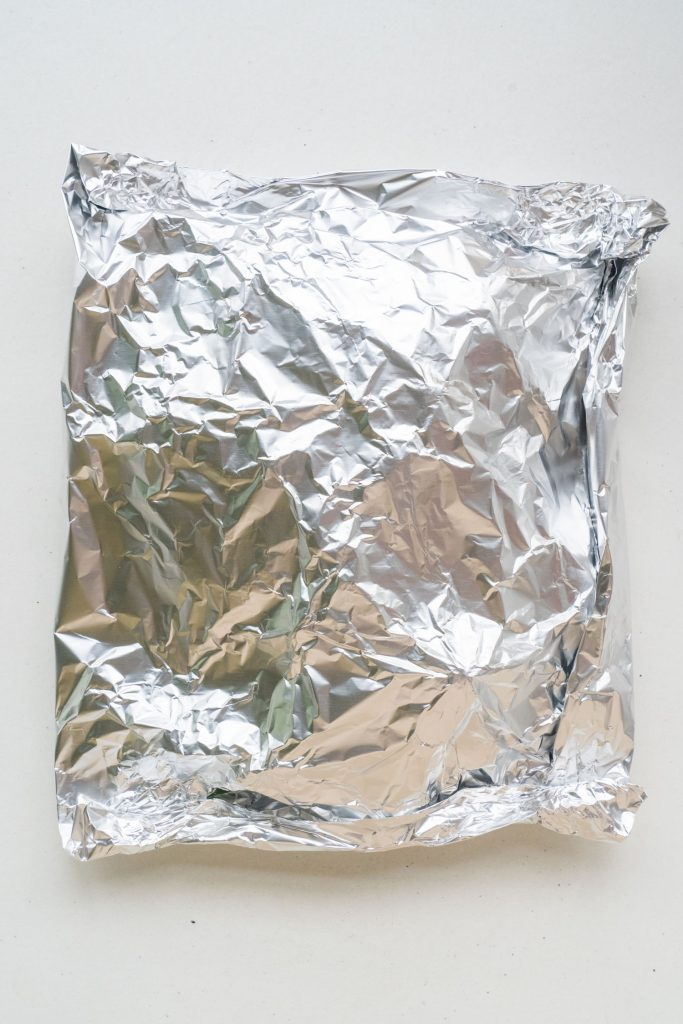 bok choy completely wrapped up in aluminum foil