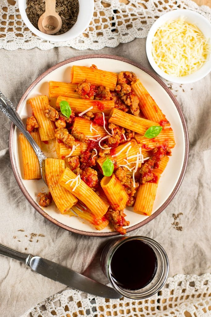 plate filled with rigatoni and sausage.