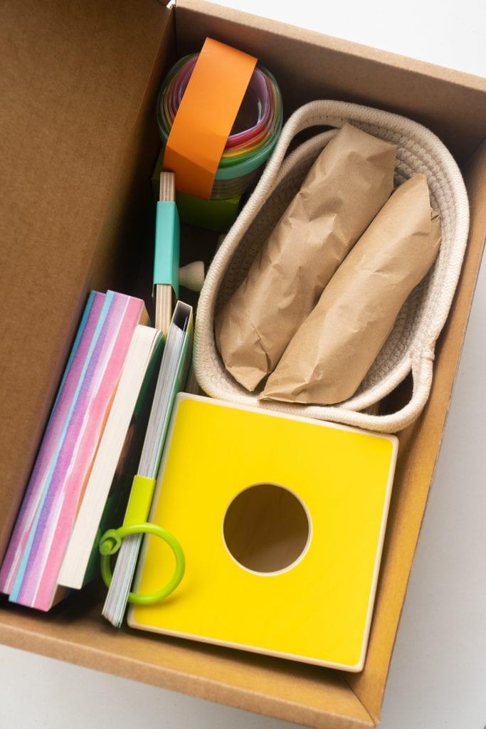 toys in cardboard box.