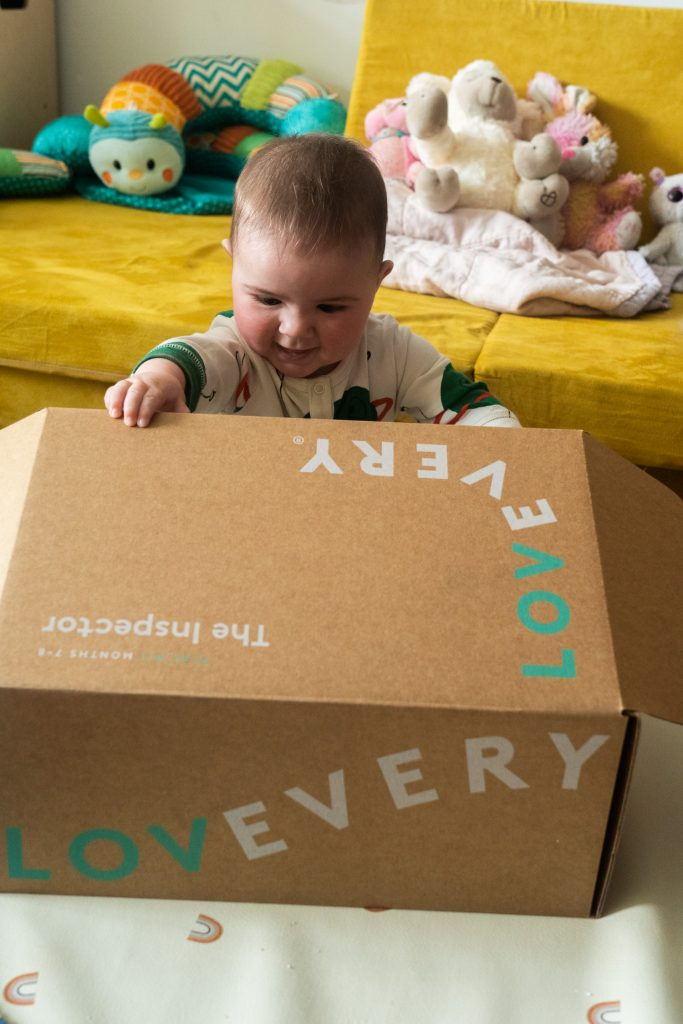 baby opening play kit cardboard box.