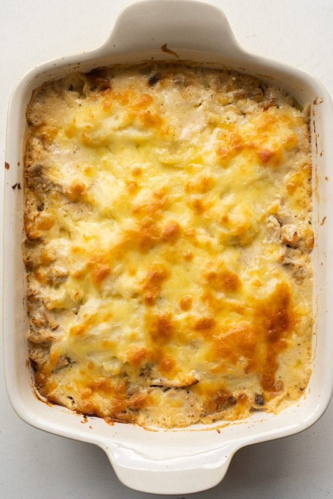 browned cheesy casserole in baking dish.