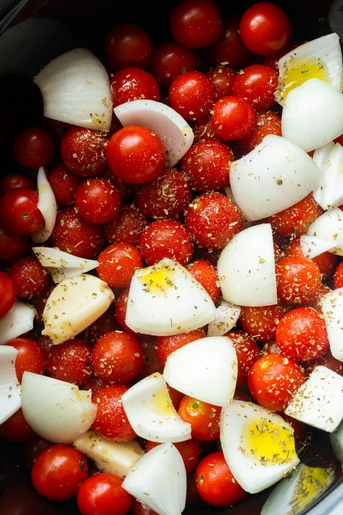 tomatoes, onion, garlic, olive oil, salt and oregano in slow cooker.