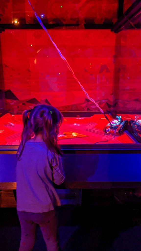 girl controlling rover robot.