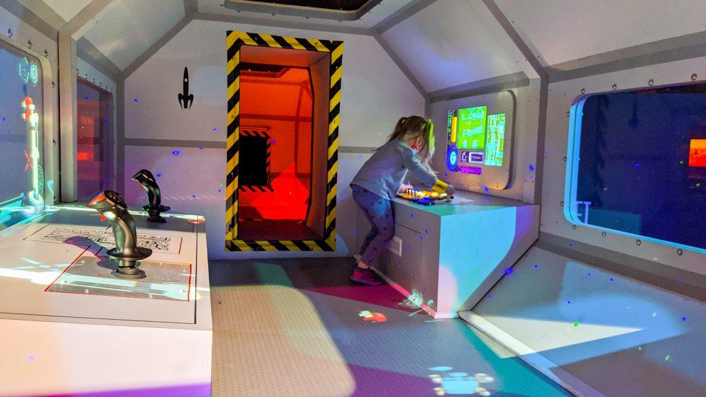 girl in space ship at cosmic camp.