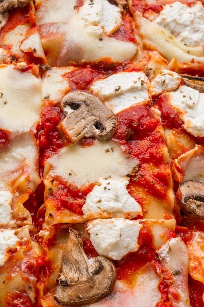 closeup of cheesy lasagna with mushrooms.